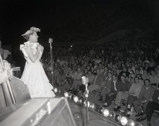 Pictured: Minnie Pearl performs on the Grand Ole Opry. The Country Music Hall of Fame and Museum's Elmer Williams Collection