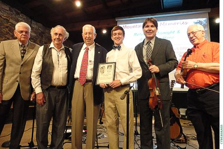 Jonathan Barker (third from right) receives the 2013 Pearl and Floyd Franks Scholarship from Randall Franks (second from right). Others joining the presentation are (from left) James Pelt, Share America Foundation secretary; Tom Morgan, entertainer; Joe Turner,  SAF chairman; and Tom Adkins, entertainer. (Share America photo)